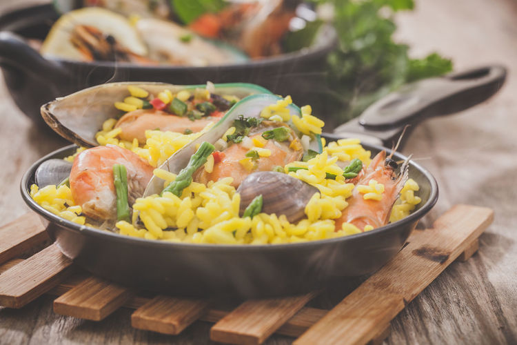 Man's accessories and jeans Clams Cooked Cuisine Food Gourmet Hot Meal Meat Mussel Paella Pan Prawn Rice Risotto Seafood SHELLFISH  Shrimp Spanish Spice Traditional
