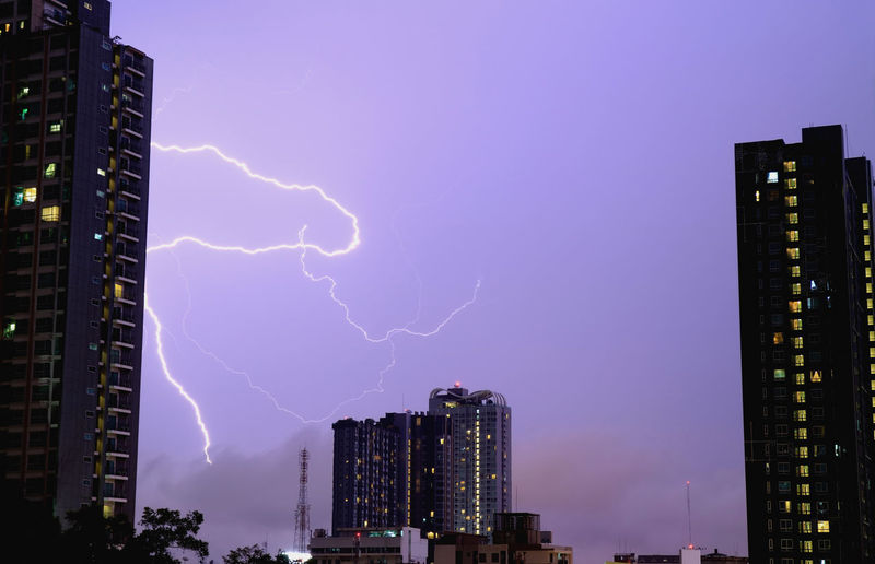 Real lightning striking on the night sky, monsoon season, Bangkok, Thailand Building Exterior Architecture Built Structure Lightning Building Power In Nature City Sky Skyscraper Cloud - Sky Power Office Building Exterior Storm Thunderstorm Night No People Nature Outdoors Cityscape Modern Light Purple Striking Monsoon Thunder