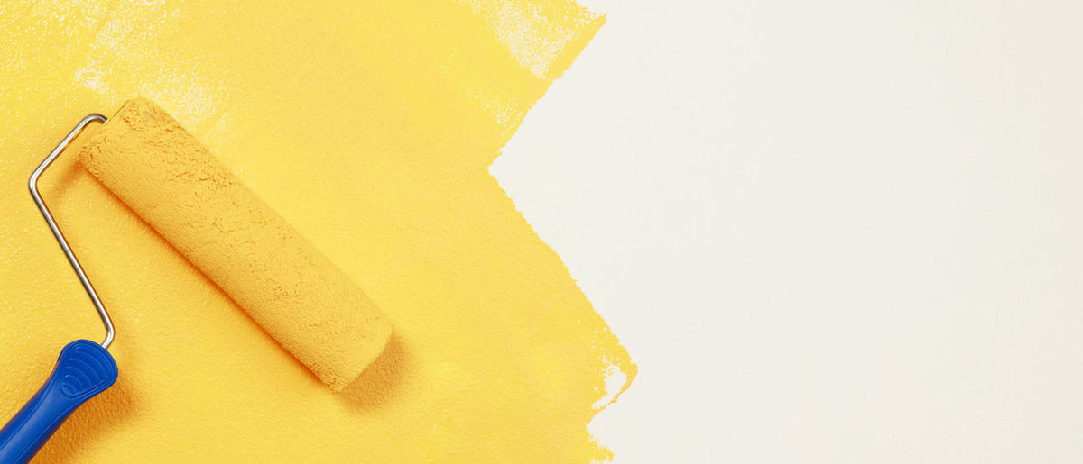 Close-up of yellow paper over white background