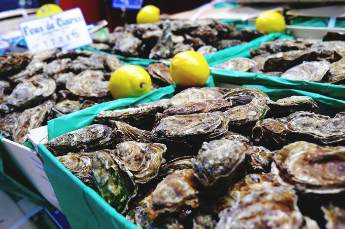 nice to photograph. but i dont like them to eat. Oyster  Huitres EyeEm Selects Taking Photos first eyeem photo Seafoods Macro Retail  Market Food And Drink Seafood Food Market Stall Consumerism Variation No People Fish Market Healthy Eating Price Tag Freshness