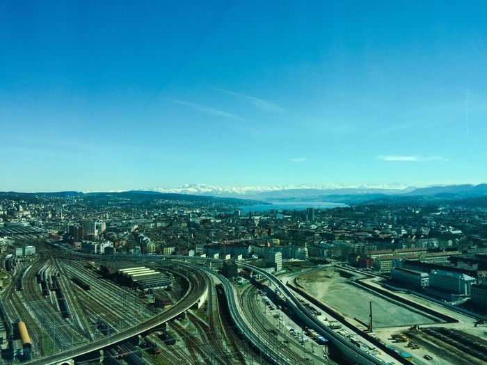 View over the City and the Lake of Zurich from Prime Tower Zürichsee Zurich, Switzerland Zürich Lakezurich Sky City Building Exterior Cityscape High Angle View Built Structure Architecture Nature Transportation No People Cloud - Sky Day Outdoors Rail Transportation Road Blue Railroad Track Track Street Multiple Lane Highway