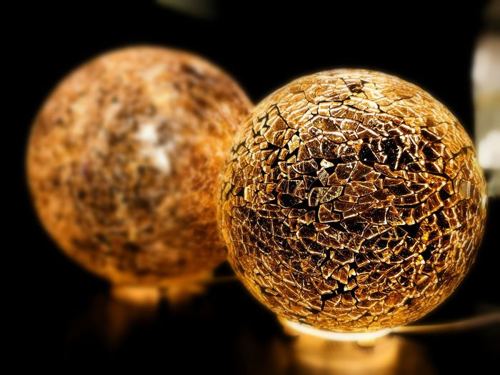 Close-up of ball balls against black background