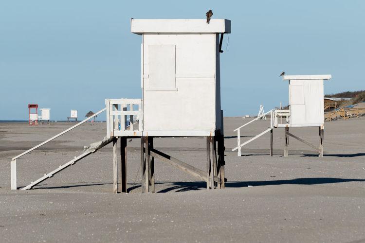 Built structure on beach against clear sky