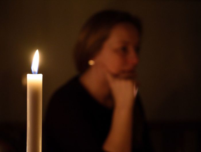 Candle Flame Burning Fire Candle Heat - Temperature Fire - Natural Phenomenon Indoors  One Person Focus On Foreground Glowing Women Dark Contemplation