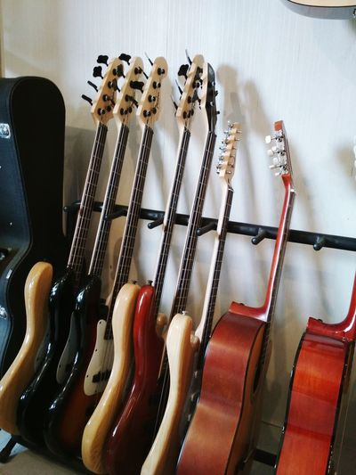 Close-up of guitars against wall