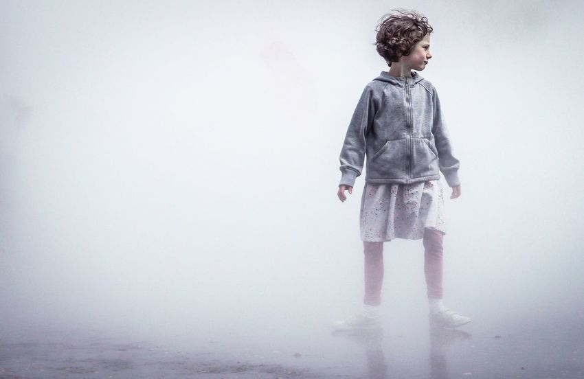Tate Fog Exhibiton, London. Girl playing Children Only Full Length Child Childhood One Person Standing One Boy Only People White Background Day Outdoors Art Is Everywhere Lonely Foggy Fog TateModern London The Street Photographer - 2017 EyeEm Awards BYOPaper!