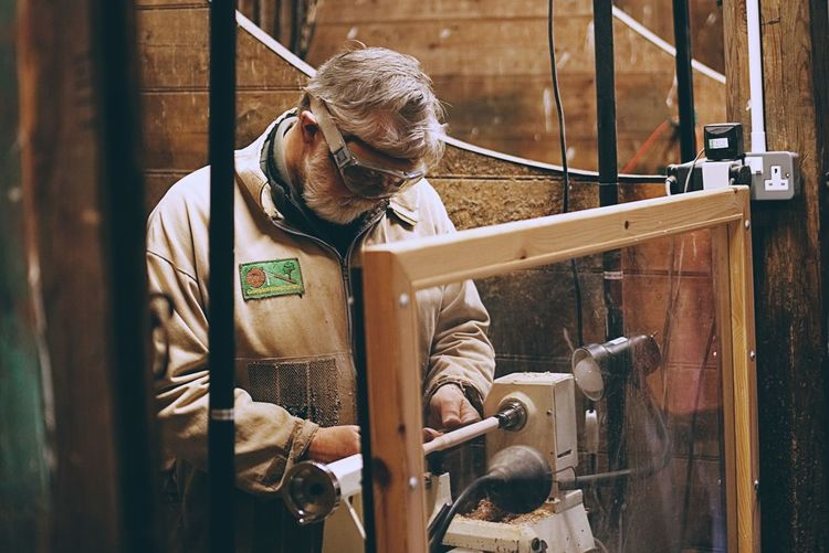 Wood turning at Crathes Castle Only Men One Man Only One Person Adults Only Working Indoors  Adult Beard Work Tool People Workshop Industry Standing Business Finance And Industry Manual Worker Wood Turning Wood Turner Woodwork  Occupation Aberdeenshire Crathes Castle