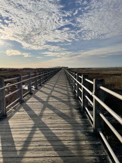Wooden bridge against sky