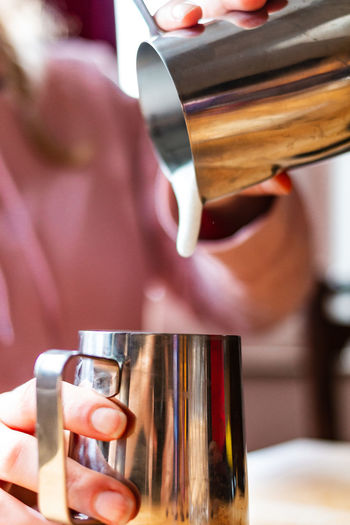 Drink Food And Drink Real People Refreshment Holding One Person Human Hand Indoors  Focus On Foreground Hand Coffee Lifestyles Women Pouring Coffee - Drink Human Body Part Drinking Glass Glass Finger