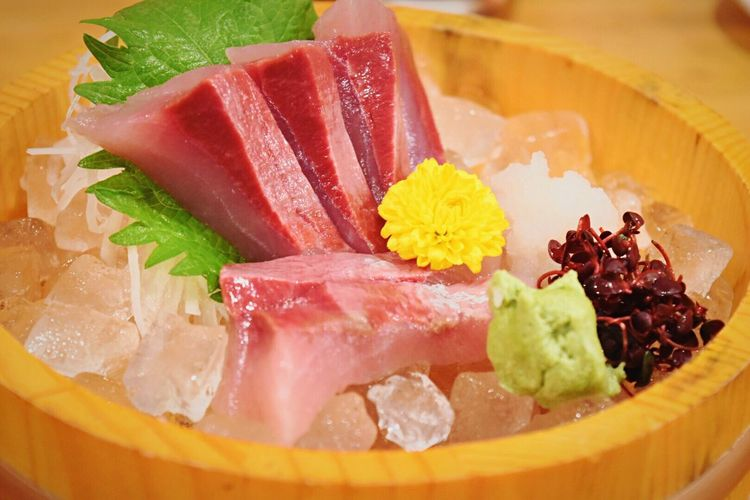 Sashimi with ice in container