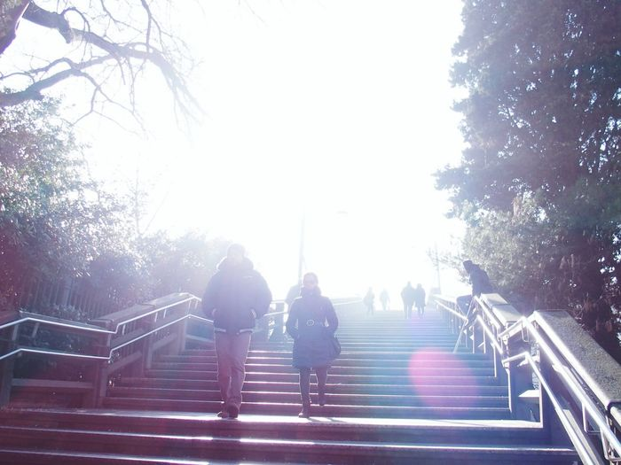 Full length of people walking on steps