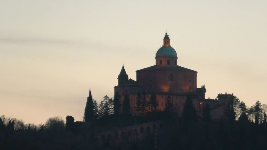 close up of San Luca basilica church on Bologna hill, in a colorful sunset. blue hour in Italy Bologna Bologna, Italy Italy San Luca San Luca's Church San Luca Bologna San Luca Skyline Church Cathedral Basilica Night Sunset Religion Dome Madonna Holy Mary Holy Virgin Madonna Di San Luca Dawn Building Exterior Built Structure Architecture Building Sky Place Of Worship Nature Belief Spirituality Tree Travel Destinations History The Past No People Plant Tower Outdoors Spire
