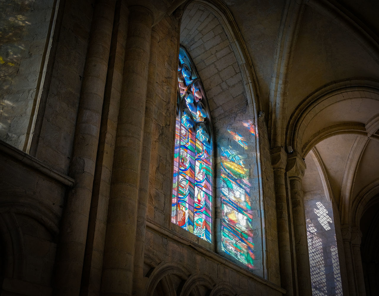 stained glass, religion, place of worship, belief, spirituality, glass, architecture, built structure, indoors, window, low angle view, glass - material, building, no people, architectural column, arch, ceiling, architecture and art, ornate