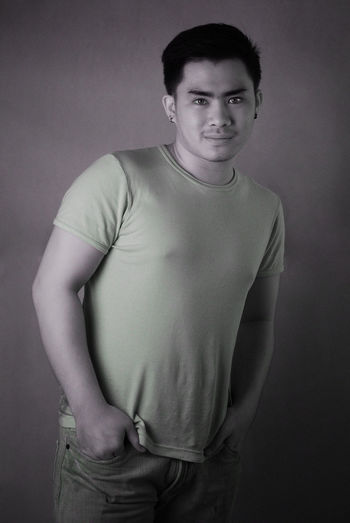 An infrared portrait of a young man. Unswapped Channel of Infrared 690nm. Infrared Color Infrared Indoors  Infrared 690nm Infrared Photography Looking At Camera One Person Portrait Real People Smile Smiling Standing Studio Shot Studio Shot Studio Waist Up Young Adult