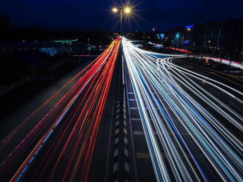 Multi coloured leading lines of a light trail on night scenery Architecture Blurred Motion City City Life High Angle View High Street Illuminated Light Trail Long Exposure Motion Multi Colored Night No People Outdoors Road Speed Street Traffic Transportation Urban Scene Vehicle Light