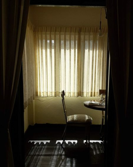 Empty chairs and table in room