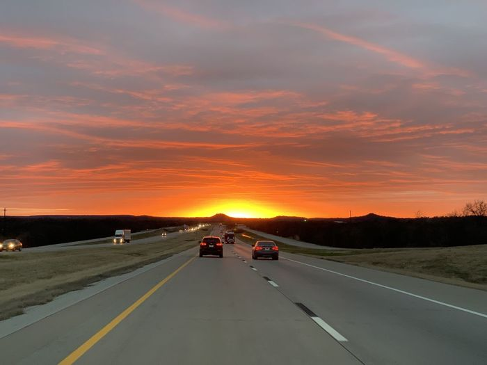 Texas Skies Transportation Road Sunset Orange Color Dividing Line Road Trip Diminishing Perspective Outdoors Travel on the move The Way Forward No People Motor Vehicle Car Sky Copy Space Direction Cloud - Sky Landscape Symbol Beauty In Nature Texas Sunset Silhouettes Idyllic Capture Tomorrow