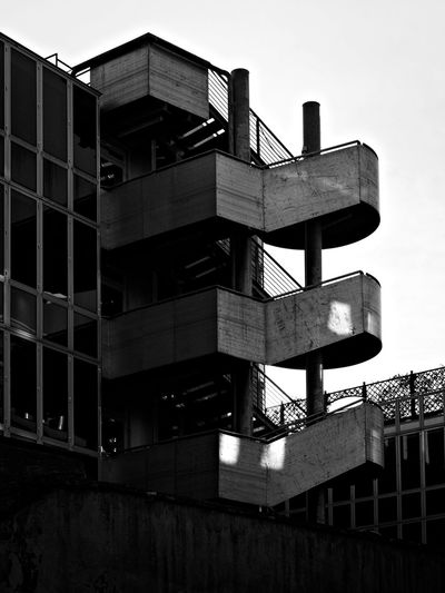 Steps And Staircases Built Structure Staircase Architecture Safety Fire Escape Urgency Steps Building Exterior No People Low Angle View Outdoors Spiral Staircase Day Sky Contemporary Architecture Architectural Detail Minimalist Architecture City Architecture_bw Minimalobsession Architectural Design Architecturelovers Architectureporn Architecture And Art