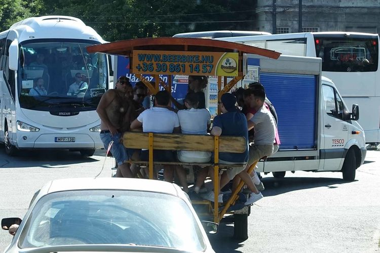 Budapest, Hungary - A beer bike full of youths Beer Bike Budapest, Hungary Day Land Vehicle Mammal Men Mode Of Transport Occupation Outdoors People Real People Rear View Standing Transportation
