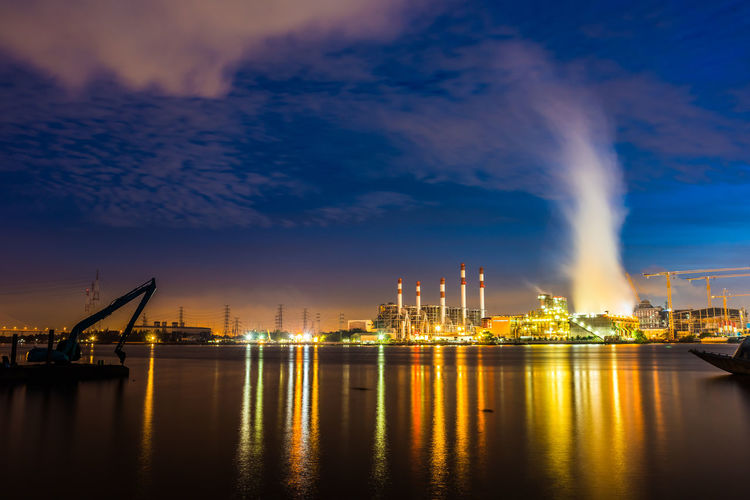 colorful plant City Water Cityscape Lightning Factory Urban Skyline Industry Illuminated Business Finance And Industry Power Station Air Pollution Pollution Water Pollution Environmental Damage Electricity Pylon