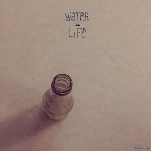 Bottle of water. Typography Phtography Creative Water