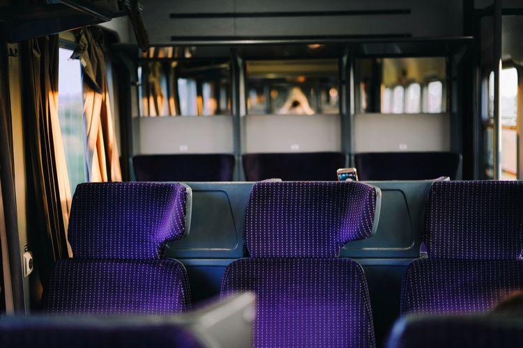 Empty purple seats in train