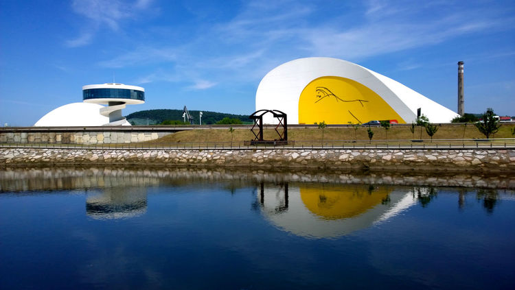 View of Niemeyer Center building, in Aviles, Spain Architecture Art Asturias Avilés Blue Building Center Cloud - Sky Cultural Culture Idyllic Landmark Landscape Museum Niemeyer Niemeyer Center Outdoors Reflection Scenics Sky SPAIN Tower Travel Water Yellow