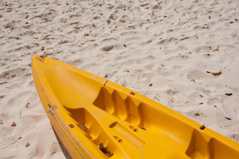 High angle view of yellow container on beach