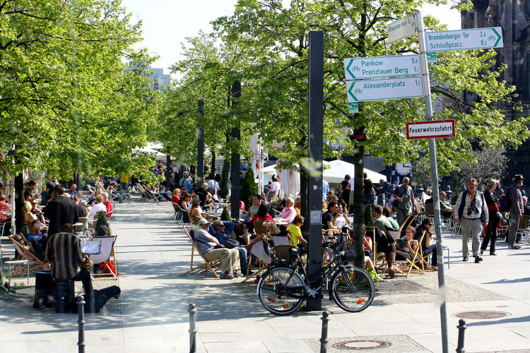 A Taste Of Berlin Berlin Photography Bicycles In Berlin Adult Berliner Ansichten Bicycle City Day Large Group Of People Men Outdoors People Street Street Directional Sign Tree #FREIHEITBERLIN