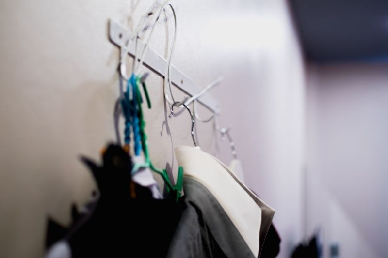 EyeEm Selects Wall - Building Feature Hanging Indoors  No People Focus On Foreground Close-up Clothing Coathanger Selective Focus Paper Still Life Art And Craft Day Rack Group Of Objects Textile Wall White Color
