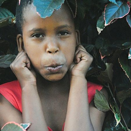 My little sister. Always in the bushes :) Sister Kidsister Family Empress child bushes nature funnyface beautiful africanchild instasize vsco vscocam mobilephotography