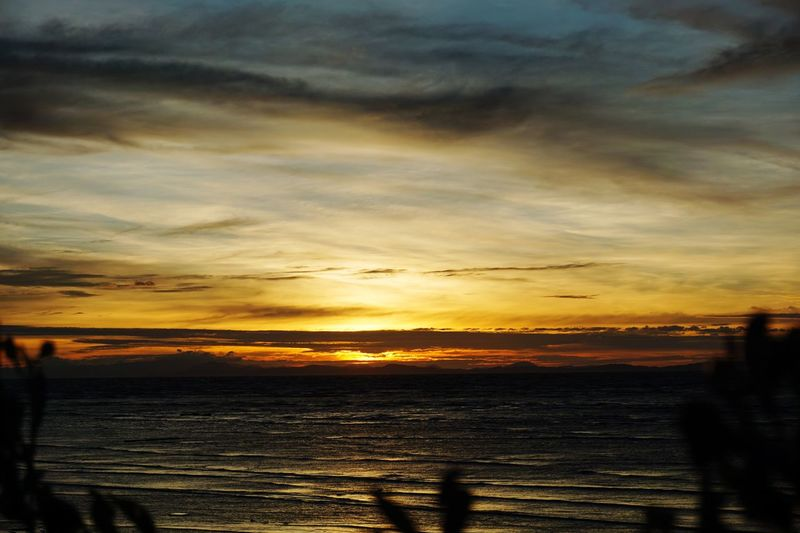 Sunset Sunset Sky Cloud - Sky Water Scenics - Nature Beauty In Nature Sea Tranquil Scene Tranquility Orange Color Nature Land Idyllic No People Beach Silhouette Non-urban Scene Outdoors Sunlight