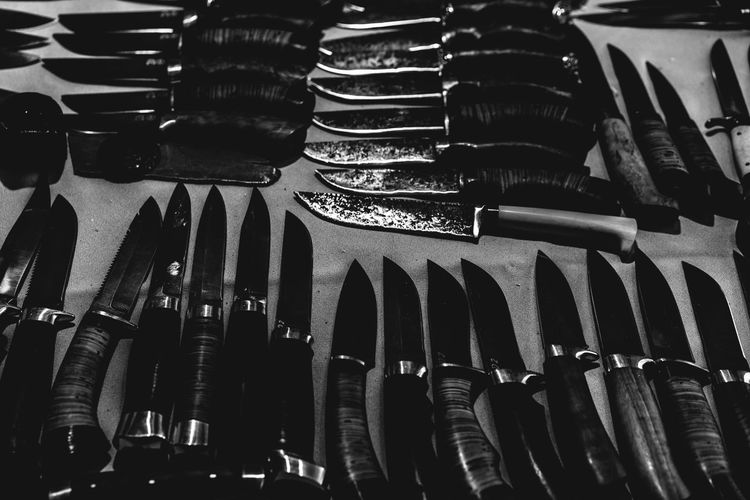 High angle view of various knives on table at market stall