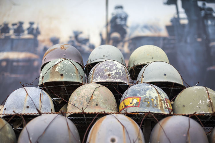 Close-up of old helmets