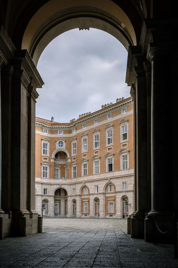 Reggia di Caserta - 2018 23mmf2 FUJIFILM X-T2 Arcade Arch Arched Architectural Column Architecture Building Building Exterior Built Structure City Cloud - Sky Courtyard  Day Fujifilm Fujifilm_xseries Fujixseries History Low Angle View Nature No People Ornate Outdoors Palace Reggia Di Caserta Sky The Past Tourism Travel Travel Destinations Window My Best Photo