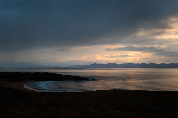 Scenic view of sea against sky during sunset. - Scotland, 2016 Sky Scenics - Nature Water Cloud - Sky Beauty In Nature Tranquil Scene Tranquility Sea Sunset Land Beach Nature Mountain Non-urban Scene Idyllic No People Environment Dusk Outdoors The Great Outdoors - 2019 EyeEm Awards