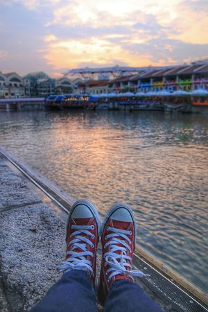Watching the sun goes down Sunset Sunset_collection Cityscapes Showcase April Reflections Water River Converse⭐ Sneakers Skyporn Sky And Clouds Relaxing