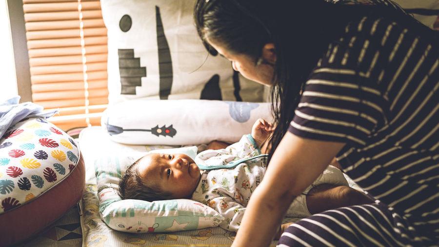 Mother talk to newborn baby