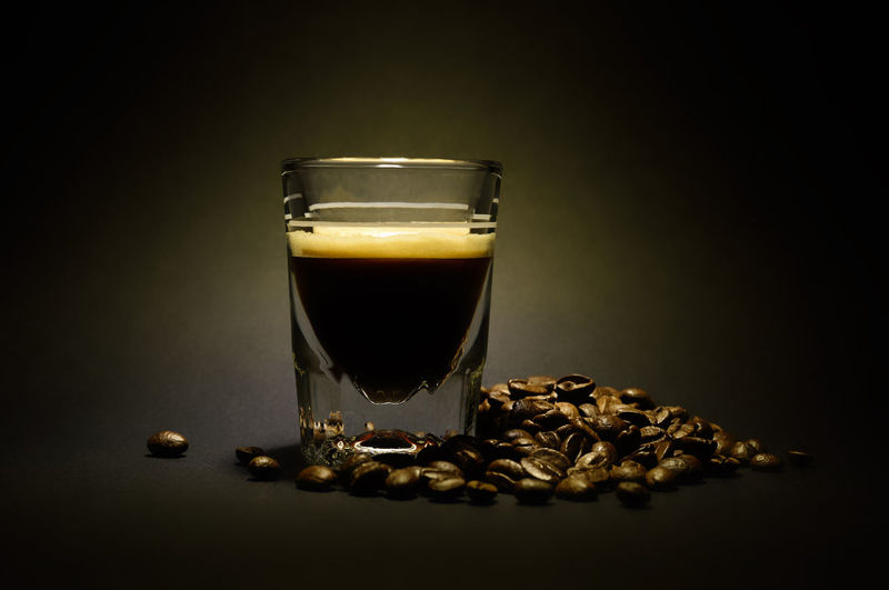 Espresso cafe Black Background Close-up Coffee - Drink Coffee Bean Drink Drinking Glass Food And Drink Freshness Frothy Drink Indoors  No People Raw Coffee Bean Roasted Coffee Bean Shot Glass Studio Shot
