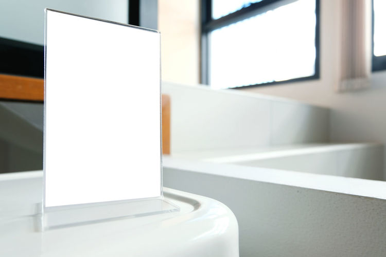 Close-Up Of Blank Placard In Bathroom
