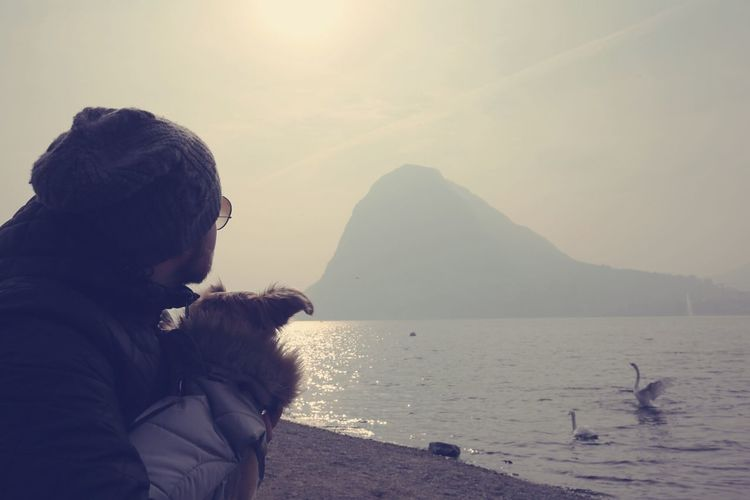 Travel Destinations Beauty In Nature Mountain People Only Men Nature Vacations Adults Only Adult Day Lake Lake View Swan Dog Dogoftheday Sun Sunlight Switzerland Lugano