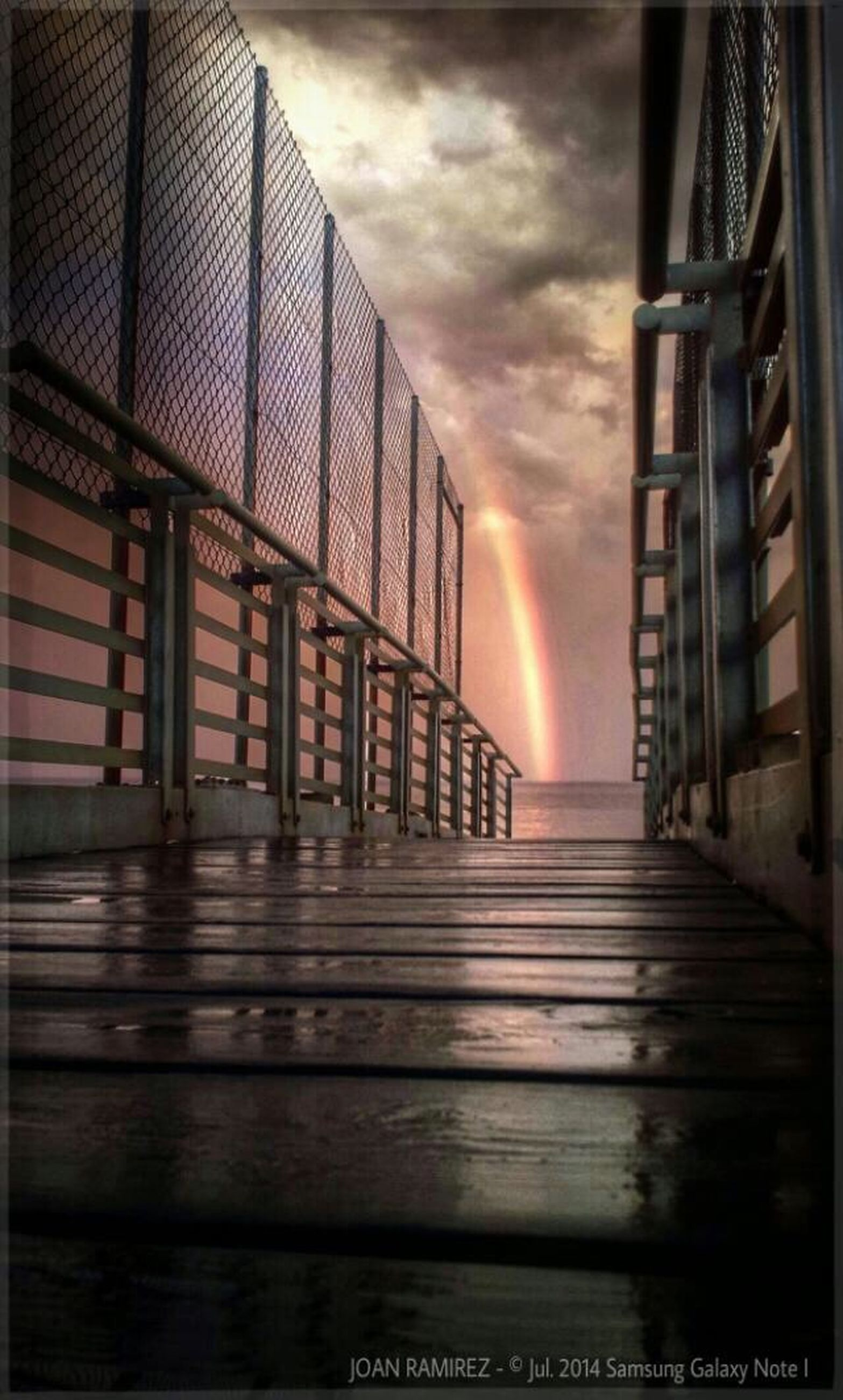 architecture, built structure, building exterior, sky, sunset, cloud - sky, low angle view, railing, building, auto post production filter, cloud, cloudy, outdoors, no people, orange color, sunlight, steps, city, day, residential structure