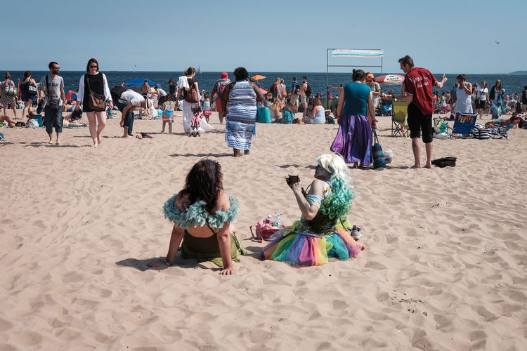 Two women lounging on the beach at Coney Island after the Mermaid Parade Beach Brooklyn Coney Island Costume Crowd Day Mermaid Parade NYC Outdoors People Real People Sand Summer Women