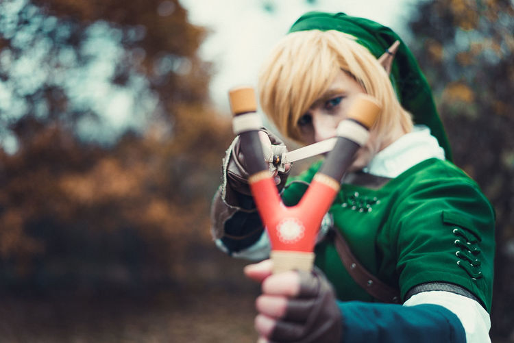 Person In Elf Costume Aiming Slingshot