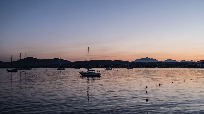 Water Sky Transportation Nautical Vessel Mode Of Transportation Sunset Beauty In Nature Reflection Travel Tranquil Scene No People Scenics - Nature Outdoors Nature Waterfront Tranquility Sea Architecture Mountain Silhouette