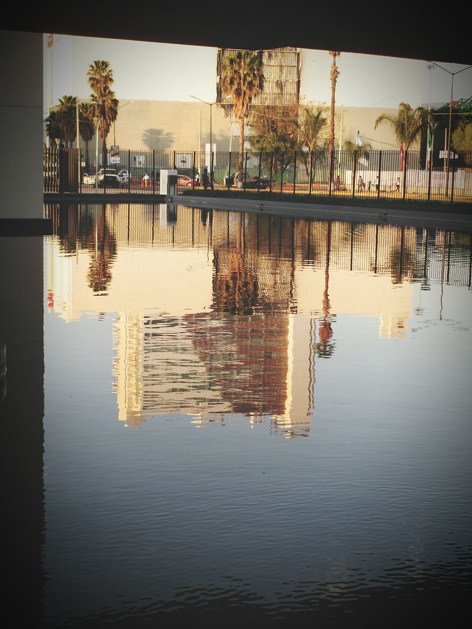 reflection, water, built structure, waterfront, architecture, building exterior, tree, day, outdoors, men, nature, sky, people