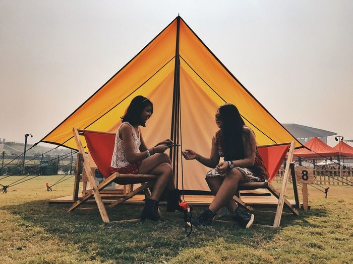 Connected By Travel Sitting Real People Leisure Activity Full Length Relaxation Sky Togetherness Lifestyles Clear Sky Two People Outdoors Casual Clothing Friendship Men Day Tent Sunset Nature Architecture Young Adult