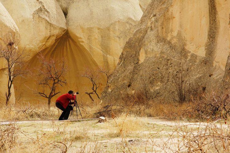 Man photographing rocks
