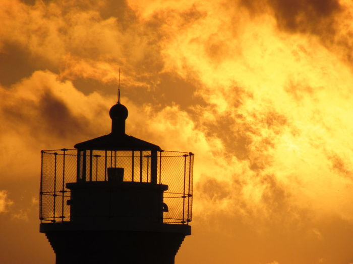 Top of a Lighthouse Architecture Beauty In Nature Building Exterior Built Structure Cloud - Sky Cloudy Dramatic Sky High Section Nature No People Observation Point Orange Color Outdoors Scenics Sky Sunset Tall - High Tower