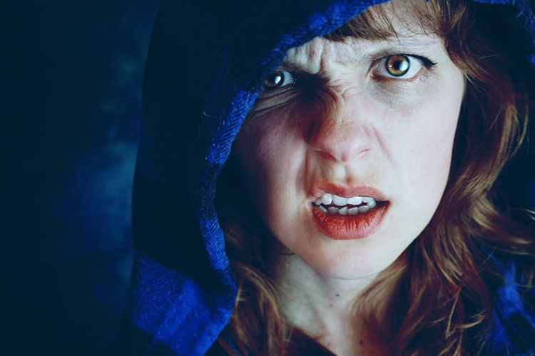 Angry Halloween Adult Blue Close-up Emotion Evil Front View Hairstyle Headshot Hood Hood - Clothing Human Face Lifestyles Lipstick Looking At Camera Make-up One Person Portrait Real People Women Young Adult Young Women